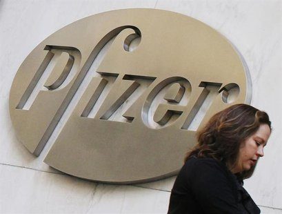 A woman walks past the Pfizer Inc. headquarters in New York, January 31, 2013.REUTERS/Brendan McDermid