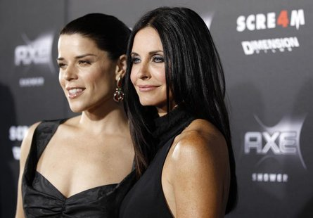 "Cast members Courteney Cox (R) and Neve Campbell pose at the premiere of ""Scream 4"" at the Grauman's Chinese theatre in Hollywood, Californi"