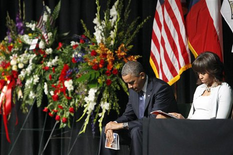 President Barack and Michelle Obama bow their heads during a memorial service for the victims of the fertilizer plant explosion last week, a