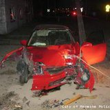 Vehicle damaged by street racing crash in Menasha on April 24, 2013. (courtesy of the City of Menasha Police Department).