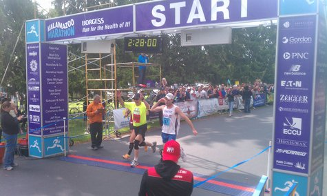 Justin Gillette crosses the finish line first at last year's Kalamazoo Marathon
