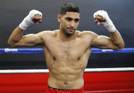 British boxer Amir Khan poses during a media opportunity at Ponce De Leon Boxing Club in Montebello, California December 11, 2012, for his u