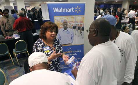 Job candidates receive information about employment at Walmart at a U.S. Congressional Black Caucus Jobs Fair in Miami, Florida August 23, 2