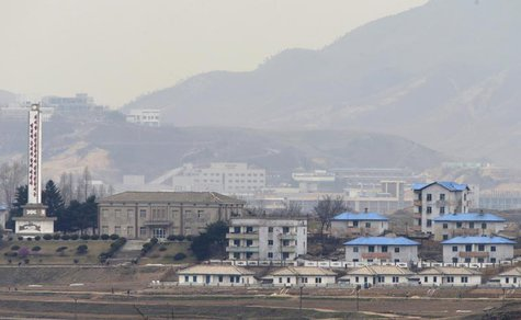 The inter-Korean Kaesong Industrial Complex is seen behind the propaganda village of Gijungdong in North Korea, in this picture taken near t