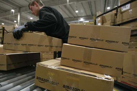 A worker carries packages for shipment at the Amazon warehouse in Leipzig, December 3, 2008. REUTERS/Fabrizio Bensch