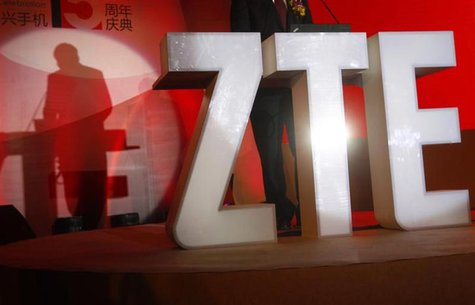 The ZTE company logo is seen as a guest delivers a speech during the company's 15th anniversary celebration in Beijing April 18, 2013. REUTE