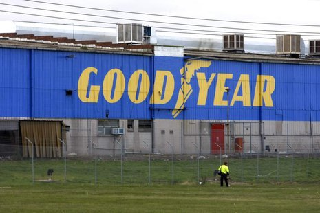 A man walks past the Goodyear logo at the South Pacific Tyres facility in Somerton, Victoria, about 20km from Melbourne, June 26, 2008. REUT
