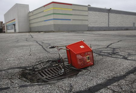 An empty shopping cart is seen outside a closed Toy R Us store in Northfield a suburb of Cleveland, Ohio, March 1, 2012. REUTERS/Shannon Sta