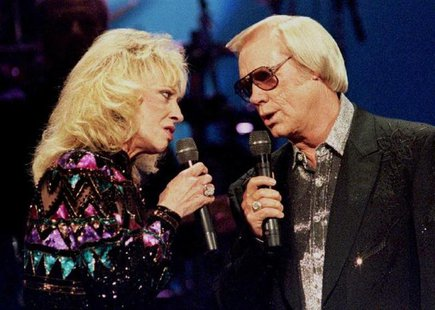 Country singer George Jones, (R) pictured with the late Tammy Wynette at the Country Music Association Awards in Nashville on October 4, 199