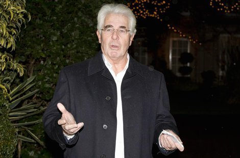 Publicist Max Clifford arrives at his home in Surrey after his arrest at Belgravia police station in central London December 6, 2012. REUTER