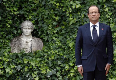 French President Francois Hollande attends as he arrives to meet Italy's Prime Minister Mario Monti at the Villa Madama in Rome September 4,
