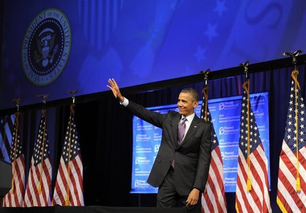 U.S. President Barack Obama waves to guests as he leaves the stage after speaking at the Planned Parenthood National Conference at the Marri