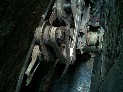 A part of the landing gear, apparently from one of the commercial airliners destroyed on September 11, 2001, is seen wedged between two buil
