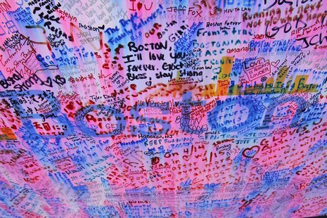 Messages at a memorial for the victims of the Boston Marathon bombings are seen in Boston, Massachusetts April 25, 2013. REUTERS/Jessica Rin
