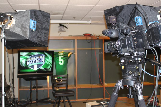 TV stations set up in the visiting team locker room