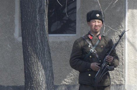 A North Korean soldier stands on the bank of Yalu River, near the North Korean town of Sinuiju, opposite the Chinese border city of Dandong,