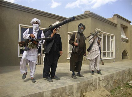 Taliban fighters pose with weapons at an undisclosed location in southern Afghanistan in this May 5, 2011 picture. REUTERS/Stringer