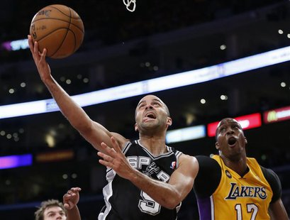 San Antonio Spurs Tony Parker (L) is fouled by Los Angeles Lakers Dwight Howard as he goes up to shoot during Game 3 of their NBA Western Co