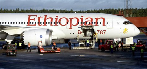 Ground crew personnel surround Ethiopian Airlines' 787 Dreamliner upon its arrival at Arlanda airport, north of Stockholm, Sweden, September