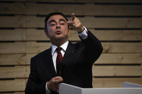 Carlos Ghosn, chairman and chief executive officer of French carmaker Renault, speaks with journalists during a meeting to promote the new e
