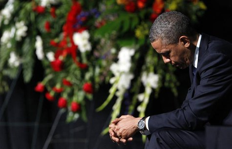 U.S. President Barack Obama bows his head during a memorial service for the victims of the West, Texas fertilizer plant explosion last week,