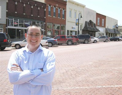 "Mike Bosch, part of a ""rural by choice"" movement, is pictured in Baldwin City, Kansas, April 24, 2013. Bosch kept his IT business instead of"