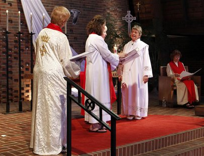 Rosemarie Smead (2nd R), a 70-year-old Kentucky woman, is ordained a Roman Catholic priest during a Celebration of Ordination at St. Andrew'