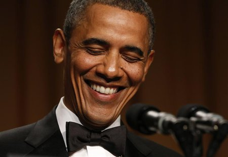 U.S. President Barack Obama laughs while speaking at the White House Correspondents Association Dinner in Washington April 27, 2013. REUTERS