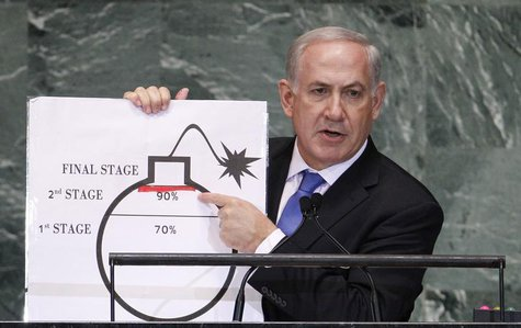 Israel's Prime Minister Benjamin Netanyahu points to a red line he has drawn on the graphic of a bomb as he addresses the 67th United Nation