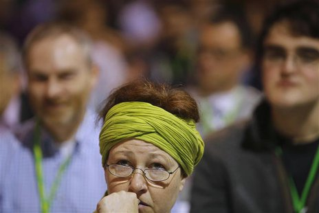 A member of Germany's environmental party Die Gruenen (The Greens) follows a debate during a party congress in Berlin, April 28, 2013. REUTE