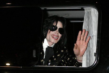 "U.S. pop star Michael Jackson waves to fans as he leaves after the ""Premium VIP Party with Michael Jackson"" in Tokyo in this March 8, 2007 f"