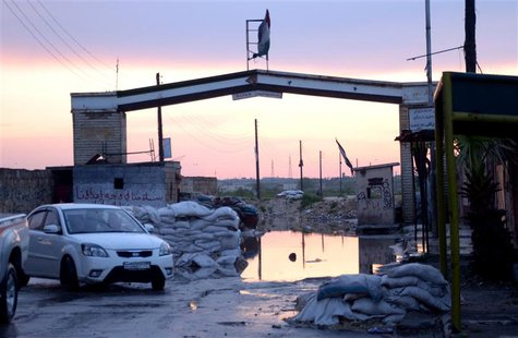 A view shows an entrance to Neirab Palestinian camp at dusk, near Aleppo International airport, April 25, 2013. Picture taken April 25, 2013