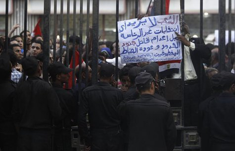 Egyptians shout slogans against Egyptian President Mohamed Mursi and members of the Brotherhood in front of the High Judicial Court during a