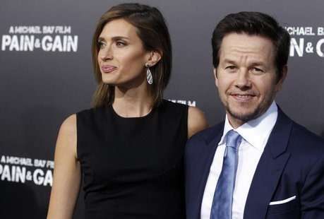 "Actor Mark Wahlberg and his wife Rhea Durham arrive at the premiere of his new film ""Pain & Gain"" in Hollywood April 22, 2013. REUTERS/Fred"