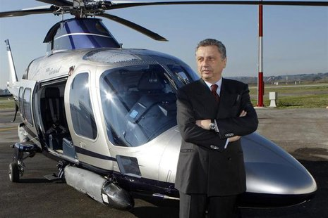 Finmeccanica Chairman and Chief Executive Officer Giuseppe Orsi poses next to a helicopter during the opening ceremony of the new Terminal o