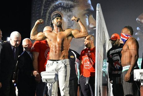 Former WBA world heavyweight champion David Haye (C) poses during his weigh-in as former British & Commonwealth heavyweight champion Dereck