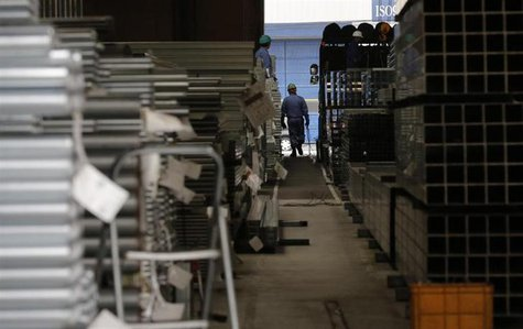 A worker walks at a factory in Urayasu, near Tokyo March 29, 2013. REUTERS/Toru Hanai