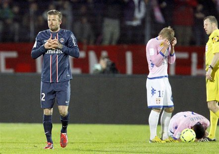 David Beckham (L) of Paris St-Germain gestures after receiving a red card during their French Ligue 1 soccer match against Evian Thonon Gail