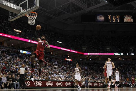 Miami Heat small forward LeBron James goes in for a dunk during the first half of Game 4 of his NBA first round playoff series against the M