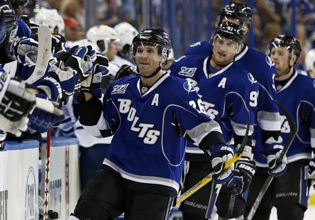 Tampa Bay Lightning's Martin St. Louis celebrates his second goal of the game during the third period of their NHL hockey game against the T