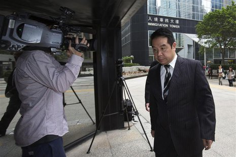 Birmingham City Football Club owner Carson Yeung (R) arrives at a district court in Hong Kong April 29, 2013. Yeung is set to appear in cour
