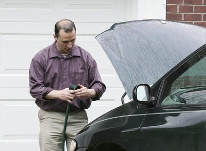 Everett Dutschke works on his mini-van in his driveway in Tupelo Mississippi on April 26, 2013. Federal agents arrested Dutschke on Saturday