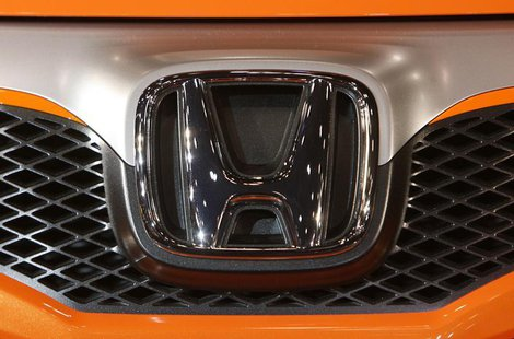 Honda Motor Co Ltd's logo is seen on the company's Sports Modulo Fit concept vehicle displayed at Tokyo Auto Salon 2009 at Makuhari Messe in