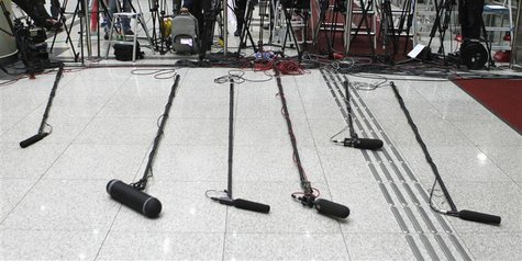 TV microphones are arranged near South Korean workers and businessmen returning from North Korea to South Korea at the customs, immigration