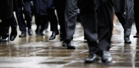 Commuters walk in to London's financial district during the morning rush hour October 7, 2008. REUTERS/Stephen Hird