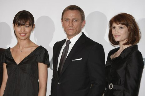 Actress Gemma Arterton (R) who plays Agent Fields, actor Daniel Craig who plays James Bond and actress Olga Kurylenko who plays Camille pose