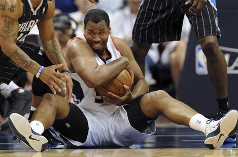 Atlanta Hawks center Jason Collins controls the ball during an NBA Eastern Conference Game 6 playoff against the Orlando Magic in Atlanta, G