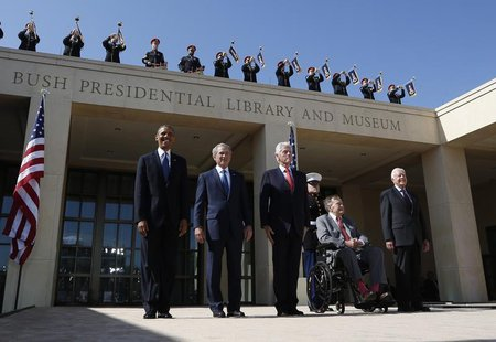 U.S. President Barack Obama (L) stands alongside (L-R) former presidents George W. Bush, Bill Clinton, George H.W. Bush and Jimmy Carter as