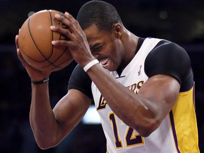 Los Angeles Lakers center Dwight Howard (12) reacts after being fouled by the San Antonio Spurs during Game 4 of their NBA Western Conferenc