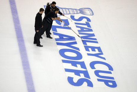 Crews prepare the ice for the start of the Stanley Cup Playoffs following the NHL hockey game between the Boston Bruins and the Ottawa Senat